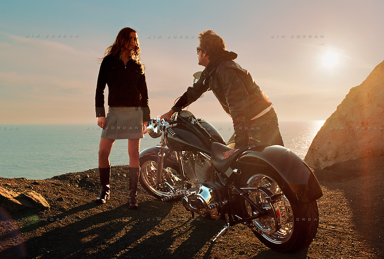 Valentinee Man and woman standing by a motorcycle(750x507)