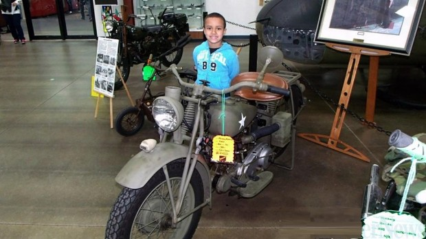 MOTORCYCLE SHOW 7 year old Jayson and armed bike